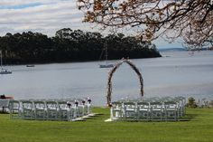 Peppermint Bay wedding ceremony with rustic twig arch, white folding chairs and rose petals Wedding Styles, Wedding Photos, Wedding Company, Folding Chairs, Tasmania, Rose Petals, Corporate Events, Peppermint, Planners