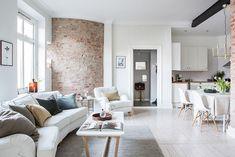 Art & Mañas » Un apartamento de una habitación con paredes de ladrillo visto y mucho blanco