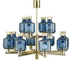 Hans Agne Jakobsson, chandelier, Markham, 1960-70s, 12-armed, brass cups in blue glass.