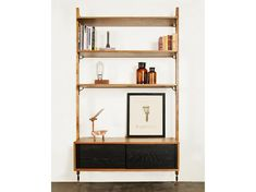 The District Eight Theo Wall Unit with Drawer is made from oak and provides a great option if you need that extra storage space. It features three large solid oak shelves with soft edges throughout and solid and veneer oak cabinet with sliding doors. Must purchase HGDA453 separately for this unit. Modular Walls, Modular Shelving, Adjustable Shelving, Oak Shelves, Glass Shelves, Storage Shelves, Extra Storage Space, Storage Spaces, Black Bookcase