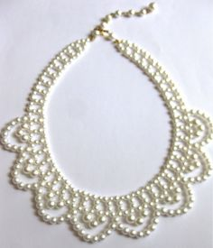 Beautiful vintage choker/necklace has multiple size white pearls and has a scalloped design. It is adjustable as shown in photo. This measures from 16 inches to 18 inches for a long look.    Beautiful for the bride, mother of the bride or After-Five fashions. This is from the 1950s era and is in great condition and well cared for.