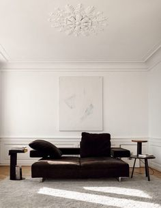 White and chocolate brown sitting room of Nathan Williams in Copenhagen. Magnus Mårding for My Residence.
