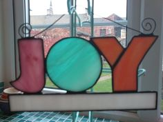 Colourful stained glass JOY sign. £20.00, via Etsy.