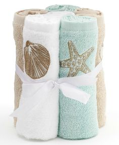 Bathroom towels with a coastal beach design! So soothing! Featured on BBL: http://beachblissliving.com/beach-bath-accessories/