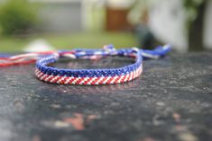 Make an American flag friendship bracelet with this tutorial.