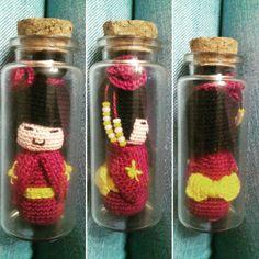 Miniature kokeshi doll in a bottle