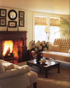 Tufted furniture, seagrass rug, bamboo blinds, fireplace, convex mirror, white bouquet...yes!