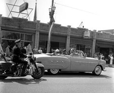 Queen Juliana of the Netherlands' motorcade visiting Fulton Street in GR; the building in the background now houses One Stop Coney Shop - 1952