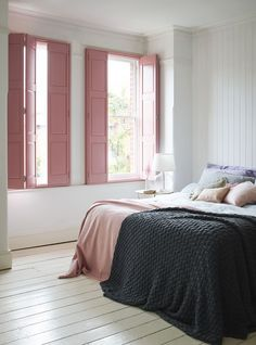 Pink solid-panel shutters give this pretty bedroom design a restful feel.theshuttersto… - ALL ABOUT Bedroom Window Design, Bedroom Shutters, Interior Window Shutters, Interior Windows, Bedroom Windows, Home Interior, Bedroom Decor, Scandinavian Interior, Window Curtains