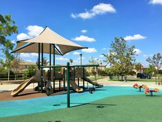 Full view of the playground for little kids at Half Moon Park in Eastvale, California. http://youreastvalerealtor.com/eastvale-parks/