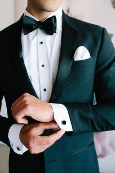 Floral wedding party style with The Black Tux party attire Floral wedding party style with The Black Tux Layer Cake) White Tuxedo Wedding, Green Wedding Suit, Groom Tuxedo Wedding, Purple Wedding, Green Tuxedo, Emerald Green Weddings, Groom And Groomsmen Attire, Groom Suits, Bow Tie Groom