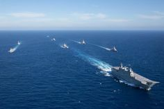 HMAS Adelaide leads a close formation of warships from the Royal Australian Navy, Royal New Zealand Navy and the Spanish Armada during a photographic exercise, part of Exercise OCEAN EXPLORER 17, off the western coast of Australia. (photo: LSIS Peter Thompson)