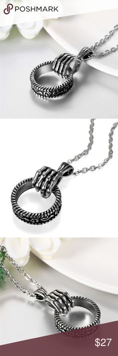 """Gothic/reaper hand & ring BRAND NEW stainless. Gothic style reaper hand & ring. Quality product made from stainless steel.   Product:              stainless steel necklace pendant Size:                    1.69""""(4.3cm)*1.55""""(1.4cm) Chain Length:       22""""(55cm)*0.1""""(0.3cm)   Color:                  Silver Material:              stainless steel Weight:               0.012kg (0.43oz)  We ship USPS  4 to 13 days delivery with TRACKING NUMBER. Ziggy Twig Jewelry Necklaces"""