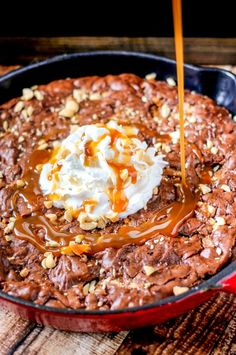 SNICKERS®️️ Skillet Brownies are ooey-gooey and full of chocolate, peanuts, and caramel. So easy to make and seriously delicious!