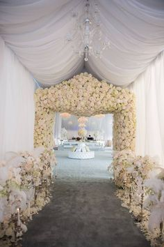 white and pink roses lining a wedding entrance
