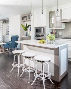 Open plan gray and white kitchen