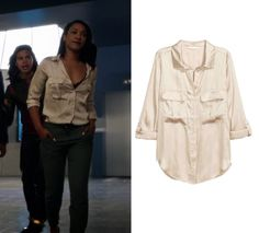 "Iris West (Candice Patton) wears this silk gold pocket front button down shirt in this episode of The Flash, The Flash Reborn"". It is the H&M Utility Shirt in Beige."