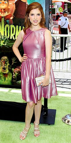 Anna Kendrick attended the premiere of ParaNorman in Universal City, Califorinia, wearing this sleeveless, pink metallic, Mulberry pleated cocktail dress.    The Twilight beauty accessorized her look with cream Herve Leger strappy sandals, sparkling diamond Kwiat gems and shimmering Edie Parker box clutch.