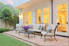Houston Homes via Cote de Texas..love this simple setting and manicured lawn... glass french doors & painted fence covered in fig ivy!
