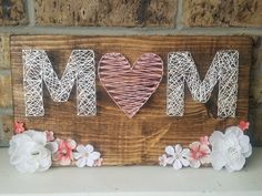 Excited to share the latest addition to my #etsy shop. With Mother's day right around the corner, here's an adorable hand made piece for that special woman in your life! #mothersdaygift #stringart #homedecor https://etsy.me/2HMnF2p