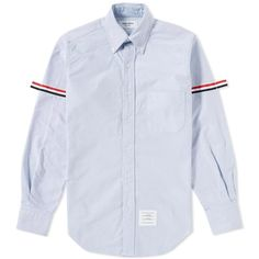 A style staple for more than half a century, the oxford shirt is a classic component of the male wardrobe. Thom Browne demonstrates his expertise in tailoring with an edge, this lightweight cotton button-down collar shirt has been crafted in the USA and cut from the highest-quality cotton. Always adding a twist to his preppy aesthetics, the shirt is finished with a striped grosgrain to either sleeve with an adjustable button detail. 100% Cotton Button Down Collar Chest Patch Pocket Grosgrain…