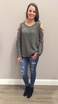 We love this unique twist on the cold shoulder with distressed sleeves! $32 #coldshoulder #cutouts #distressed #newarrivals #apricotlane #apricotlanedesmoines