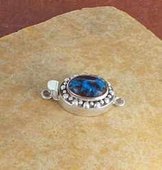SHATTUKITE CLASP Sterling Oval 14x10mm from New World Gems