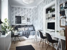 Bedroom with wallpaper and workspace