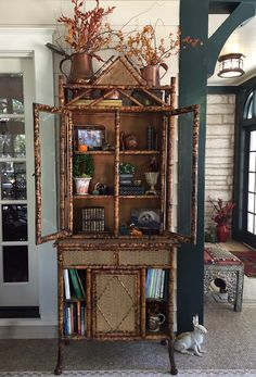 Gorgeous bamboo cabinet on sun porch via HYACINTHS FOR THE SOUL