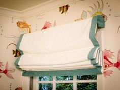Space-Saving Window Treatment in A Tween Girl's Underwater-Themed Bedroom  from HGTV