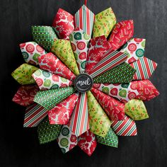 Give any entryway or wall a delightful decoration with plenty of dimension with this Christmas Paper Wreath! Constructed by using scrapbook paper turned into paper cones, this wrea Christmas Scrapbook Paper, Christmas Paper Crafts, Christmas Door Decorations, Diy Christmas Ornaments, Holiday Crafts, Christmas Wreaths, Diy Christmas Wall Decor, Christmas Truffles, Scrapbook Paper Crafts