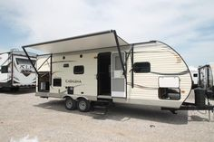 "BEAUTY AND COMFORT!!!  2016 Coachmen Catalina Summer Edition 233DS With an exterior camp kitchen you can make amazing dishes out in the fresh open air! With a furnace and an a/c unit this rig is ready to go any time of year. You can enjoy the great view while having breakfast looking out the large picture window next to the dinette! This rig is 28' 10"" long and has a dry weight of 5,687 lbs. Give our Catalina Summer Edition expert David Hobbs a call 435-932-0616 for pricing and more info!"