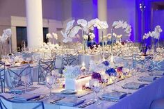 Modern white decor with blue and purple accents and lighting