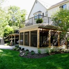 Get the most from your backyard space with a deck and screen porch. Designed with an under deck drainage system, the porch remains dry. And the exterior knee wall was finished in Stucco to match the home.