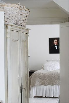 white cupboard and baskets