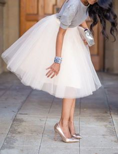 Try pairing a tutu skirt with a soft cashmere sweater. An all timer winning look!