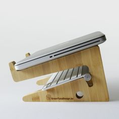 unique puzzle shaped laptopstand in sustainable bamboo wood.. €62,50, via Etsy.