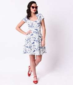 20,000 leagues of maritime magnificence! A nautical frock fresh from Steady, complete in a fabulously fanciful navy blue retro diver print with terrifying Krakens, vintage divers, submarines and more! Crafted in a comfortable white stretch knit that shows off your figure with stunning seafaring sensibility, with short sleeves that complement a flattering queen anne neckline. A seamed natural waistline flows into a  lightweight flared A-line skirt in a simple pull on design, topping off this…