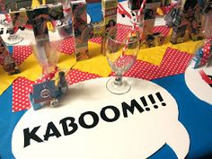 Cut white cardboard, add letters... perfect placemats for a superhero party.