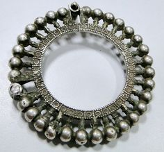 Old silver hinge bracelet bangle from Rajasthan. Silver guard bangles (Khatria or bangri gokru) with balls perimeters. Worn by Dangee and Patel peoples. Silver Jewellery Indian, Tribal Jewelry, Silver Jewelry, Solid Silver Bracelets, India Jewelry, Cool Necklaces, Fantasy Jewelry, Antique Jewelry, Jewelery