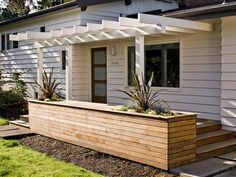 pergola and wood box as border for behind family room