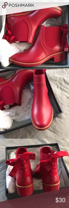 Red Rain Booties Red Rain Booties with tie detail in back only worn for a photoshoot (5 min top)  https://bernardo1946.com/collections/rain-boots/products/paigerain-red bernado Shoes Winter & Rain Boots