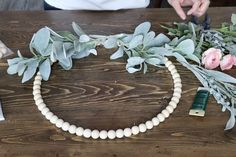 An easy and inexpensive way to change up your front door for spring! You will need floral stems/ greenery stems pre-drilled wood beads glue scissors… Wood Bead Garland, Beaded Garland, Diy Wreath, Door Wreaths, Coaster Crafts, Leather Wall, Floral Hoops, Wine Glass Charms, Wreath Forms