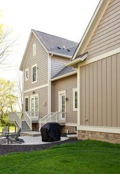 This color combo - tan siding, darker stone, cream trim, brown windows