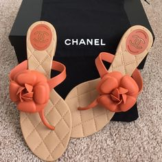"Authentic CHANEL camellia rubber thong sandals Gently worn, mint condition; no damage or flaws. Approximate sole length: 9 3/4"" They come with dust bag but NO box. These sandals are about a US size 6.5 CHANEL Shoes Sandals"