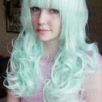 From Dreamy's Twin Tails Collection that feature a full, soft and curly base with two detachable pony tails. So you can wear this as casually or as cute as you like!  This is cute soft Mint wig is sure to freshen up any co-ord or pastel outfit.  Perfect for a Sweet Lolita to Fairy-kei to Daily wear!     This wig is heat resistant up to 70°C...