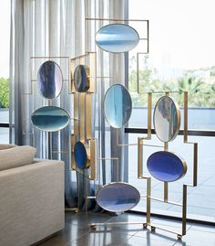 The limited-edition, Aurora Folding Screen designed by feature a range of blue hues which change tone as the light reflects off the oval resin. Screen Design, Unique Furniture, Furniture Design, Furniture Decor, Partition Screen, Holly Hunt, Room Screen, Interior Decorating, Interior Design