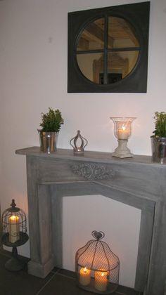 fausse cheminee avec miroir et bougies