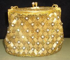 Hey, I found this really awesome Etsy listing at https://www.etsy.com/listing/104468769/vintage-handbag-gold-delill-profoundly