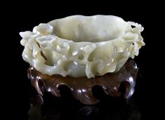 A Chinese Carved Jade Water Coupe, Width 5 1/2 inches.